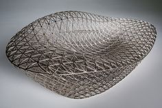 This 3D-printed sofa is made from a mesh inspired by the structures of spiderwebs and silkworm cocoons »