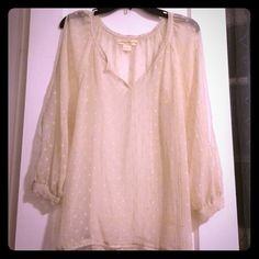 Sheer staring at stars cream top. Size small Sheer staring at stars top. Size small. Never worn great condition. Cut out sleeve style Urban Outfitters Tops