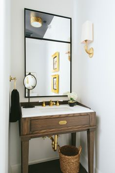 """""""Throw symmetry out the window by offsetting one or more of the components,"""" suggests Marker. """"A side wall with a faucet pouring into a centrally located sink or an offset mirror shakes things up a bit. A lone light fixture adhered to the side wall is a nice departure from the two-sconce status quo."""""""