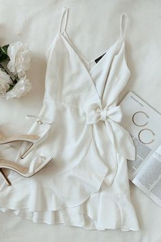 Lulus A white wrap dress outfit for every bridal event on the calendar. Make you… Lulus A white wrap dress outfit for every bridal event on the calendar. Make your special day complete with simple gold hoops and white ankle strap […] Cool Summer Outfits, Cute Casual Outfits, Casual Dresses, Fashion Dresses, Maxi Dresses, Wrap Dresses, Fashion 2018, Ladies Fashion, White Summer Dresses