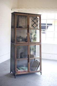 Industrial Modern Glass Door Storage Cabinet Bookcase This unique rustic industrial modern cabinet features wood framed glass doors. Slanted Design that is slimmer at the top Dimensions: x x Materials: Metal, Wood, Glass Glass Shelves In Bathroom, Floating Glass Shelves, Bathroom Storage, Bookcase With Glass Doors, Glass Cabinet Doors, China Cabinet, Wood Storage Cabinets, Door Storage, Display Cabinets