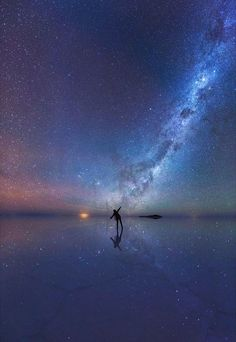Imagine a still night, no wind, and a mirror perfectly reflecting the night sky at your feet. That's what photographer Xiaohua Zhao came across while shooting in the world's largest salt flat, the Salar de Uyuni of Bolivia.
