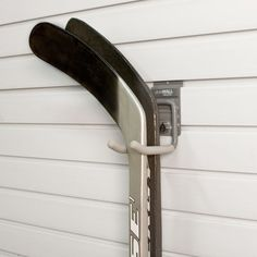 storeWALL's Universal Hook protects hockey sticks better than the corner of the room