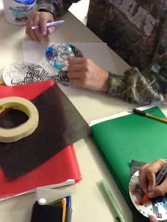 Art at Becker Middle School: Creating radial balance on CDs