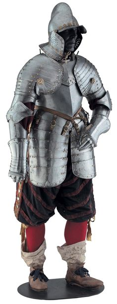Demi-armure de fantassin, Suisse vers 1630. A Swiss infantry half-armour, circa 1630. Comprising burgonet with one-piece skull rising to a comb cabled with close-set finely incised lines over the top, fitted with pointed peak, matching neck-guard, a pair of pierced hinged cheek-pieces also matching, the edges turned and cabled en suite with the comb, fitted with modern brass plume-holder and studded with brass-capped rivets and rows of lining rivets on modern rosette washers