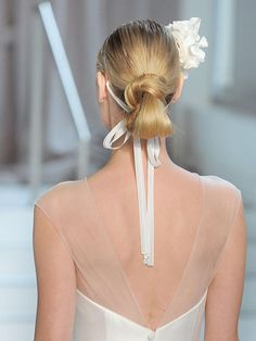 Twist a low bun at the nape of your neck for a chic wedding hairstyle straight off the runway.