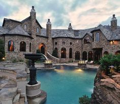 When you live in a house that looks like a castle a moat is obviously a requirement. -- See more dream pools: http://porch.com/advice/these-10-dream-pools-will-inspire-your-ultimate-landscape-makeover/