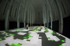 French artist Miguel Chevalier's light installation Magic Carpet 2014 transformed the former Church of the Sacred Heart in Casablanca, Morocco into a psychedelic, interactive display of shape and color.