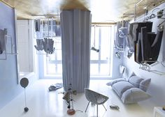 Theres an upside-down living room on the ceiling of this Polish fashion boutique created by design studio smallna for fashion brand Risk. Made in Warsaw