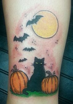 Halloween inspired cat and pumpkin tattoo.  Done by tom hacic @ redhouse tattoo