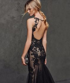 Stunningly sexy mermaid style gown. Gorgeous black lace over a nude shell to give the illusion of something more…or something less. The dress has a deep v-neck top with lace, tank style straps and sexy open back. The train can be customized to your preferred length and style.  Dress is lovingly handmade to order and takes approximately 4-6 weeks to complete. Rush orders are available depending on the time of year. Please send a private message for more details and additional costs. I know…