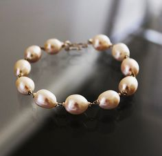 Pearl Wedding Bracelet  White Baroque Pearls by karioi on Etsy, $205.00 http://etsy.com/shop/karioi