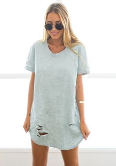 Best Seller // Aiming for a grunge look? This grey crew-neck ripped tunic will definitely help you achieve that look so easily.