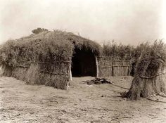 Here for your enjoyment is an interesting photograph of an Indian Grass House in the Cahuilla Desert in California. It was made in 1924 by Edward S. Curtis.  The photo illustrates a grass home used by the Indians of North America.