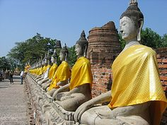 Line of seated buddhas at the Wat Chai Mongkul in Nakhon Si Ayuthaya #Thailand #WorldHeritage
