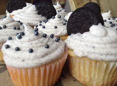 i don't think this could get any more delicious..an oreo truffle, inside a cupcake, with oreo butter cream icing <3