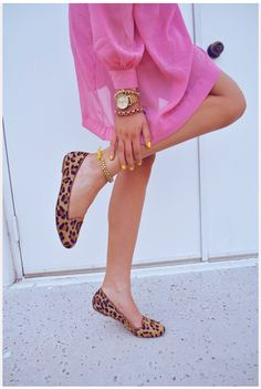 Leopard loafers, yellow nail polish and bright pink coat. Oh my god, I die.
