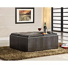 @Overstock - This faux alligator leather storage ottoman features a padded top can serve as a footrest or extra seating. The top of this ottoman flips open to reveal convenient storage space.http://www.overstock.com/Home-Garden/Faux-Alligator-Leather-Print-Cocktail-Storage-Ottoman/4819940/product.html?CID=214117 $245.99