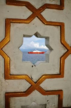 Most of people in Ternate is moslem.  This ship photograph was taken from inside of a the biggest mosque in Ternate. Part of it built on the sea. Great mosque.