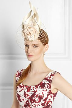 Ivory parasisal Silver comb to secure Spot clean This product will arrive in signature Philip Treacy packaging