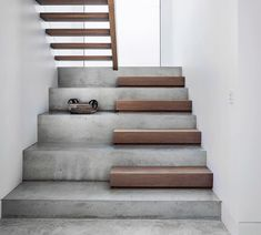 An opaque full-height window illuminates this beautifully simple thoroughfare. The stairs are polished concrete with European oak treads, stained to match the ground floor. styling by and photographed by stairs Concrete Stairs, Concrete Floors, Concrete Houses, Concrete Garden, Stairs Architecture, Interior Architecture, Interior Stairs, Home Interior Design, Concrete Interiors
