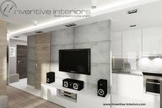 Projekt salonu Inventive Interiors - szare płyty dekoracyjnego betonu na ścianie TV