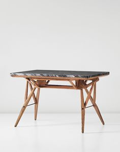 Carlo Mollino; Nero Marquina Marble, oak and Brass Table for Società Reale Mutua di Assicurazioni by Apelli & Varesio, c1946.