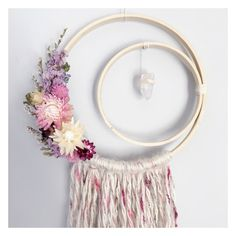 Crescent moon dreamcatcher with raw quartz hanging down to symbolize a star. Beautiful, real dried everlasting flowers with wool yarn and a wooden