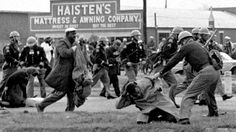 State troopers swing billy clubs to break up a civil rights march in Selma, Ala., on March 7, 1965. The day would later become infamously kn...
