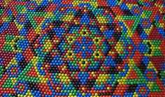 Photographer Vern Hart didn't mean to start creating art with M's—while watching a movie, he began to assemble the candies in this geometric pattern. Before he knew it, he'd used approximately 2,068 M's to complete the design. Although he enjoyed creating this work, he prefers eating candy to playing with it. Photo courtesy of Vern Hart via Flickr.com