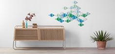 Marcel is a smart sideboard made of wood and tubular metal inspired by the Modern Cultural Movement developed during the interwar period.