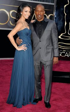 """""""Django Unchained"""" star Jamie Foxx was upstaged on the red carpet by his stunning 19-year-old daughter Corinne, who was dressed in a strapless midnight blue gown with woven bodice. The actor, who brought along the beauty – then just 11! – to the Oscars in 2005 when he won for """"Ray,"""" gushed on the red carpet that he was """"excited to show how beautiful my daughter has turned out."""""""