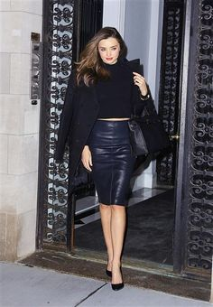 Miranda Kerr looked super-chic in a navy leather pencil skirt, a crop top and simple black heels.