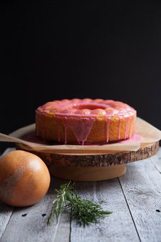 A beautifully pink bundt cake of Grapefruit, Rosemary & Cornmeal. Adapted from What Katie Ate. Perfect for Easter or a pink-themed birthday party!