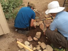 WMG apprentice Zach and Van work on rocking a water channel near the house.