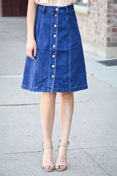 The denim skirt trend is back in full force, and we are not mad about it! This Button Front Denim Skirt is the most darling thing we've seen. We love the button detail down the front. Material 99% Cot