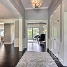 Gorgeous foyer featuring Restoration Hardware Victorian Hotel Pendant, walls painted in Sherwin Williams Light French Gray, millwork painted in Sherwin Williams Alabaster.#paint #foyer #design