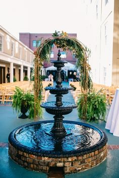 A serene wedding scene from the DoubleTree Charleston Historic District's charming courtyard.
