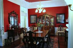 A red dining room! But the beautiful crown molding adds to the beauty!