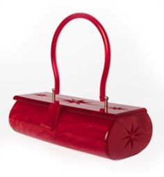 Red lucite by Lux De Ville...a unnecessary necessity every stylish chique woman needs