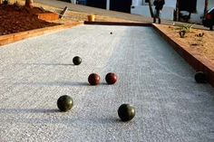 bocce court crushed oyster surface ; Gardenista Official dimensions of a court are 86.92 feet long by 13.12 feet wide