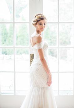 Romantic off-the-shoulder form fitting wedding dress: http://www.stylemepretty.com/2016/02/17/romantic-wedding-dresses/