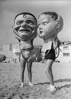 Giant paper mache masks hanging out on Venice Beach during Mardi Gras, 1935