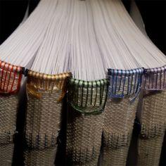colorful hand stitched headbands on handmade books