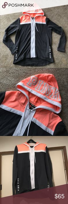 Victoria's Secret PINK Colorblock Zip Hoodie Never worn! Brand new zip up hoodie. No tags. Bright peachy-orange color on the top and dark charcoal gray grey on the bottom with white trim and details. Very cute! Such pretty color combinations! Cute and snug ;) PINK Victoria's Secret Jackets & Coats