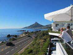 Cape Town is an incredibly beautiful city, but one of the best spots to grab a drink and watch the sun set is at the 12 Apostles Hotel & Spa with views of the nearby mountains.