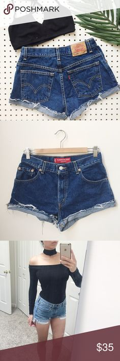 Vintage Levi's High Waisted Cut Off Denim Shorts Vintage 550 Levi's high waisted denim cut off shorts. Can also be worn uncuffed for a even more undone look. Get the Laid-back, cool girl vibe by pairing them with a relaxed fit tee and white sneakers. Ps..they also make your butt look nicer! *Same one I wore in pictures just different size & darker color.* Tag says 8 but fits like 26/27 or S. But double check measurements!! Waist: 13.5 Hip: 19.5 Front rise: 10.5 Inseam: 2 Levi's Shorts Jean…