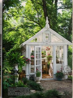 Greenhouse-oasis. This would look so cute in a corner of your backyard.