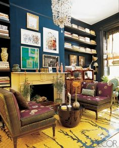 Navy walls, glass chandelier, dark shelving, purple chairs Brandolini study ED0106
