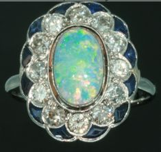Opal with diamond and sapphire engagement ring